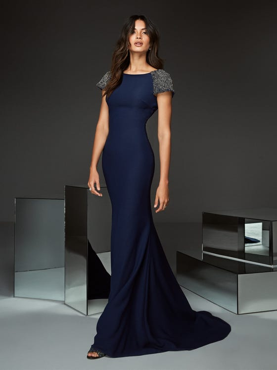 Front of  long mermaid blue cocktail dress with short sleeves and open back  Pronovias